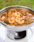 Acacia Leave Omelet and Shrimps in Spicy Tamarind Flavored Soup. Royalty Free Stock Images