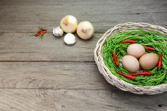 Acacia pennata and egg in basket on wood background Stock Photography