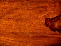 That acacia timber, trim with rosewood red wooden background. Vintage surface royalty free stock photos