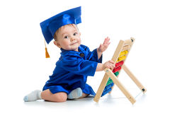 Academic baby playing with abacus toy. Academic baby boy playing with abacus toy Royalty Free Stock Images