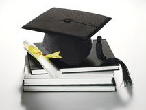 Academic cap and diploma Royalty Free Stock Photography