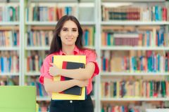 Free Academic Girl Holding Her Book And Papers In A Library Stock Images - 109971484