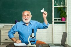 Academic success is much more about hard work than inborn talent. School concept. Old bearded mature teacher. Exam in stock images