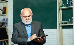 Academic success is much more about hard work than inborn talent. Teacher preparing for university exams. Old bearded royalty free stock photos
