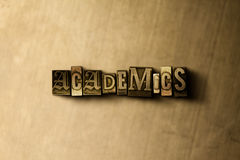 ACADEMICS - close-up of grungy vintage typeset word on metal backdrop Royalty Free Stock Photo