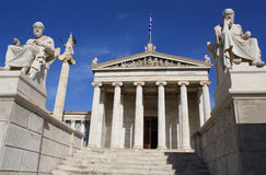 Academy of Athens. Neoclassical Academy of Athens in Greece showing main building and statues of ancient Greek philosophers Plato (left), Socrates (right) and royalty free stock photography