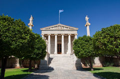 Academy of Athens with Plato and Socrates monument. Royalty Free Stock Images