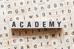 Academy word concept on cubes stock photo