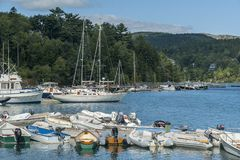 Small boats lining waterfront in Acadia National Park Royalty Free Stock Photo