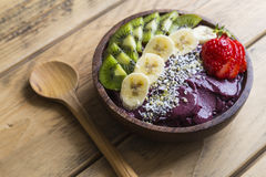 Acai bowl. Bowl of acai purée with toppings of banana, kiwi, strawberry and seeds Royalty Free Stock Photo