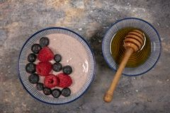 Acai bowl with raspberries and blueberries royalty free stock image