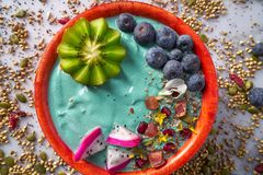 Acai bowl smoothie with kiwi blueberry seeds. And pitaya dragon fruit Stock Photos