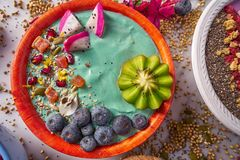 Acai bowl smoothie with kiwi blueberry seeds. And pitaya dragon fruit Royalty Free Stock Images