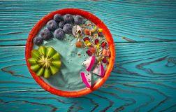 Acai bowl smoothie with kiwi blueberry seeds. And pitaya dragon fruit Royalty Free Stock Photo