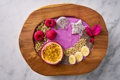 Acai bowl smoothie with passion fruit and raspberries. Acai bowl smoothie with passion fruit maracuya seeds banana and raspberries Stock Photos