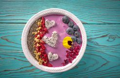 Acai bowl smoothie pitaya hearts blueberry goji. Chia pomegranate and seeds for Valentines day Stock Photography