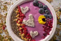 Acai bowl smoothie pitaya hearts blueberry goji. Chia pomegranate and seeds for Valentines day Stock Images