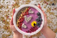 Acai bowl smoothie pitaya hearts blueberry goji. Chia pomegranate and seeds for Valentines day Royalty Free Stock Photo