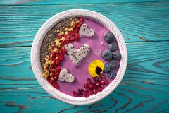 Acai bowl smoothie pitaya hearts blueberry goji. Chia pomegranate and seeds for Valentines day Royalty Free Stock Photos