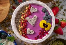 Acai bowl smoothie pitaya hearts blueberry goji. Chia pomegranate and seeds for Valentines day Stock Photos
