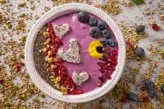 Acai bowl smoothie pitaya hearts blueberry goji. Chia pomegranate and seeds for Valentines day Stock Image