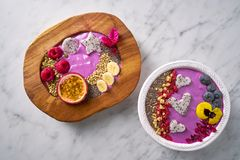 Acai bowls smoothie with passion fruit pitaya. Banana and berries Royalty Free Stock Images