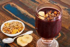 Acai in glass with muesli banana Royalty Free Stock Photography
