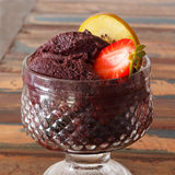Acai pulp in glass with strawberry and kiwi Royalty Free Stock Photography