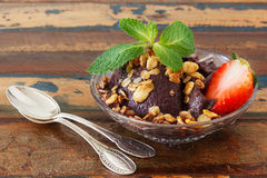 Acai pulp in glass with strawberry, muesli and fresh mint Royalty Free Stock Photography