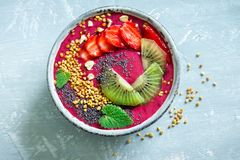 Acai smoothie bowl. With chia seeds, fruits, berries strawberries and bee pollen for healthy vegan vegetarian diet raw breakfast. Breakfast smoothie bowl on Stock Photo