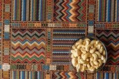 Acajounüsse auf einem Teppich Lizenzfreie Stockbilder