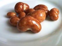 Acajounuss in einer Schokoladenbeschichtung Lizenzfreie Stockfotografie