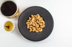 Acajounuss mit Tee und Kaffee Lizenzfreies Stockfoto