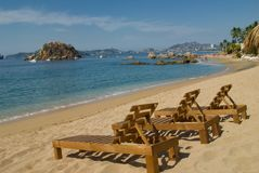 Acapulco Beach. Three Wooden chase with Great view of Acapulco Bay, Mexico Royalty Free Stock Photos