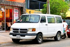 Dodge Ram Van. Acapulco, Mexico - May 30, 2017: White minibus Dodge Ram Van in the city street royalty free stock images