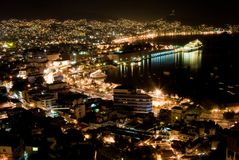 Acapulco Nights. Ariel Nighttime view of Acapulco Mexico with the Zocolo area in the foreground and cruise ship in port. Long exposure for motion blur of cars ( Royalty Free Stock Images