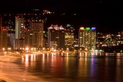 Acapulco Nights. Ariel Nighttime view of Acapulco Mexico Beach & Resort Area Stock Photo