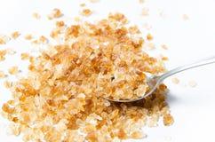 Açúcar da rocha com colher Fotos de Stock Royalty Free