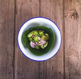 Acar. Islamic dish made of cucumber slices and onions in vinegar Stock Image
