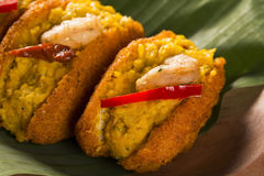 Acaraje - Traditional Brazilian fritters made with black-eyed pe. As filled with vatapa, caruru, tomato salad and sauteed shrimp. Typical food from Bahia Stock Images