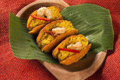 Acaraje - Traditional Brazilian fritters made with black-eyed pe. As filled with vatapa, caruru, tomato salad and sauteed shrimp. Typical food from Bahia Royalty Free Stock Photography