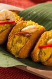 Acaraje - Traditional Brazilian fritters made with black-eyed pe. As filled with vatapa, caruru, tomato salad and sauteed shrimp. Typical food from Bahia Stock Photos