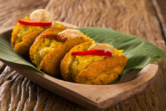 Acaraje - Traditional Brazilian fritters made with black-eyed peas filled with vatapa, caruru, tomato salad and sauteed shrimp. Typical food from Bahia Royalty Free Stock Photo