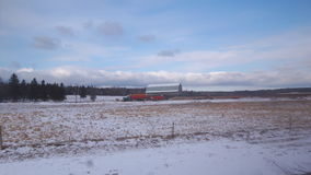 Acasian Farm  in winter. Farm fields with a light covering of snow in  Southeast NB Canada. It& x27;s Feb and the lack of snow triggers thought of global warming Stock Photography