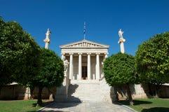 Accademia di Atene e delle statue davanti, Grecia Fotografia Stock Libera da Diritti