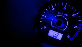 Accelerate!!! BLUE. Tachometer @ night - blue royalty free stock photo