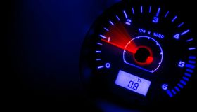 Accelerate!!! RED & BLUE. Tachometer @ night - red and blue version Royalty Free Stock Image