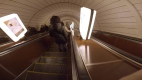 Accelerated descent on the long escalator of the Kiev underground. Ukraine stock footage