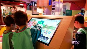 Accelerated learning techniques, modern education system, Children move their fingers along large touch screen, child stock video footage