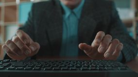 Accelerated motion of office clerk hands in plaid jacket typing on keyboard stock footage